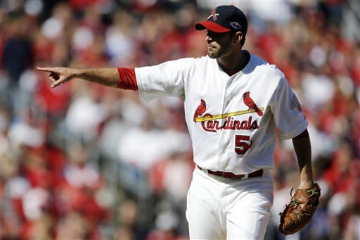 St. Louis Cardinals starting pitcher Adam Wainwright point after striking out Washington Nationals' Ryan Zimmerman to end the top of the first inning in Game 1 of baseball's National League division series, Sunday, Oct. 7, 2012, in St. Louis. (AP Photo/Jeff Roberson)