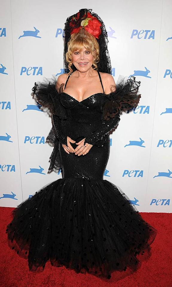 "59-year-old Charo is muy caliente for her age, but this sequined eyesore -- complete with headdress -- is so not ""cuchi-cuchi."" Jeffrey Mayer/<a href=""http://www.wireimage.com"" target=""new"">WireImage.com</a> - September 25, 2010"