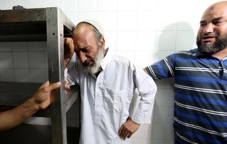 A relative of a Palestinian Islamic Jihad militant, who was killed in an Israeli tank shelling that targeted an observation post, reacts at a hospital in the southern Gaza Strip May 27, 2018. REUTERS/Ibraheem Abu Mustafa
