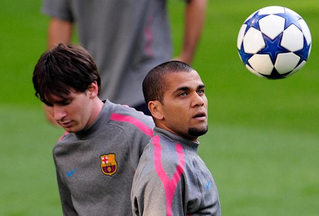 Barcelona's Brazilian defender Dani Alves (R) and Barcelona's Argentinian forward Leonel Messi take part in a training session at Santiago Bernabeu stadium in Madrid on April 26, 2011, on the eve of the Champions League semi-final first leg football match between Real Madrid and Barcelona. AFP PHOTO / DANI POZO (Photo credit should read DANI POZO/AFP/Getty Images)