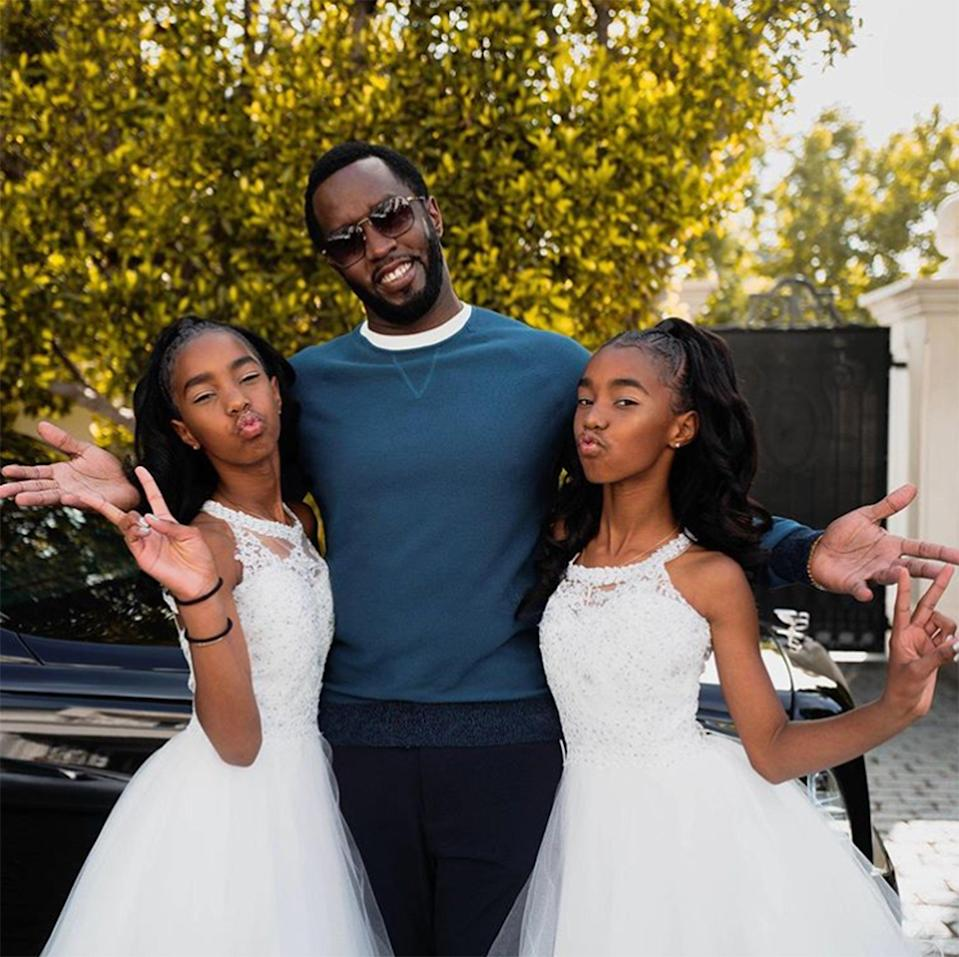 """Sean """"Diddy"""" Combs' twin daughters are all grown up! D'lila Star and Jessie James have graduated from the eighth grade and daddy Diddy could not be happier. """"MY BABIES ARE GRADUATING!!!!! Man s--- is real! I FEEL SO GOOD. SO HAPPY. SO PROUD. 🖤,"""" Diddy captioned a <a href=""""https://www.instagram.com/p/ByWU3LJnJWz/"""" rel=""""nofollow noopener"""" target=""""_blank"""" data-ylk=""""slk:photo"""" class=""""link rapid-noclick-resp"""">photo</a> of himself sandwiched between both of his girls. He also tagged the late Kim Porter's Instagram handle, """"@ladykp,"""" at the end of his post to honor the girls' mother, who died in November 2018 at age 47 from lobar pneumonia."""