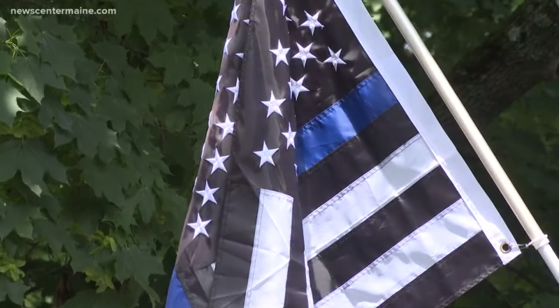 "The ""Thin Blue Line"" American flag that has become associated with the Black Lives Matter movement and was used by white supremacists during the violent Charlottesville, Va. rally has ignited a heated controversy in York, Maine. (Credit: New Center Maine)"