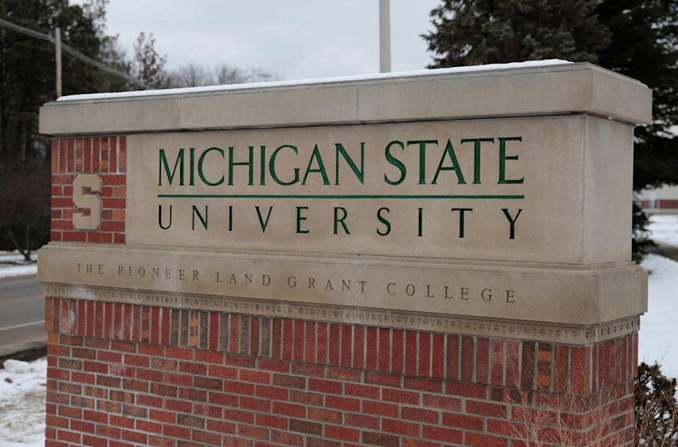 A sign for Michigan State University is seen near the campus in East Lansing.