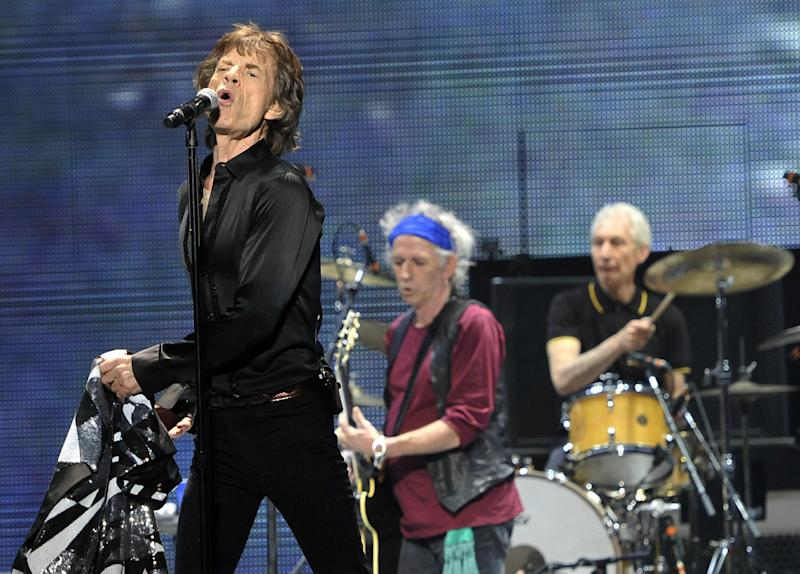 "Mick Jagger, left, Keith Richards, center, and Charlie Watts of the Rolling Stones perform on the kick-off of the band's ""50 and Counting"" tour at the Staples Center on Friday, May 3, 2013 in Los Angeles. (Photo by Chris Pizzello/Invision/AP)"
