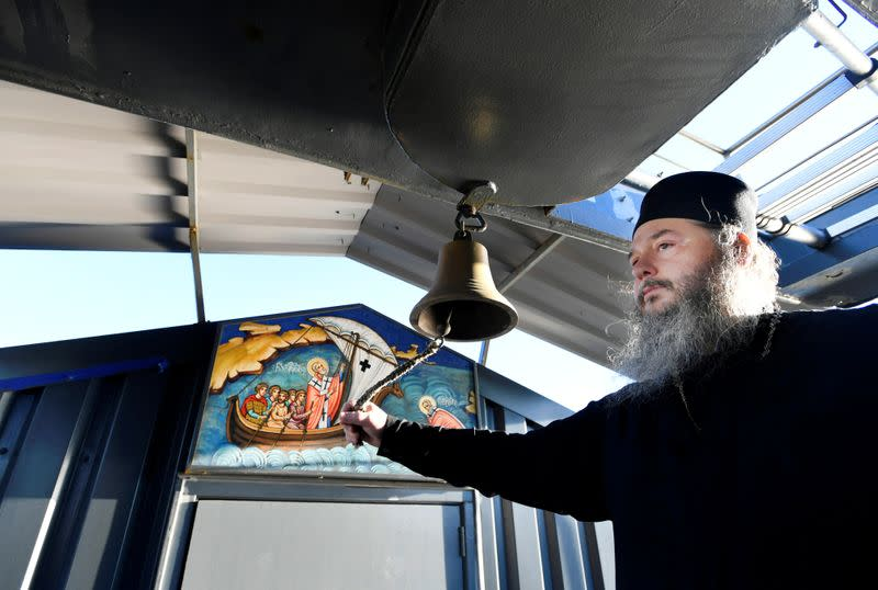 Father Abbot Abibon lets the church bell ring of a mobile Georgian Orthodox monastery in Vlissingen