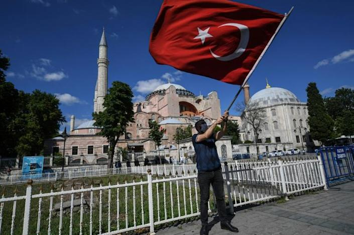 Turks began celebrating after a top Turkish court revoked Hagia Sophia's status as a museum, clearing the way for it to be turned back into a mosque (AFP Photo/Ozan KOSE)