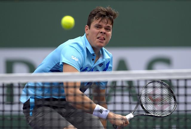 Milos Raonic, of Canada, hits to Alexandr Dolgopolov, of Ukraine, during a quarterfinal at the BNP Paribas Open tennis tournament, Thursday, March 13, 2014, in Indian Wells, Calif. (AP Photo/Mark J. Terrill)