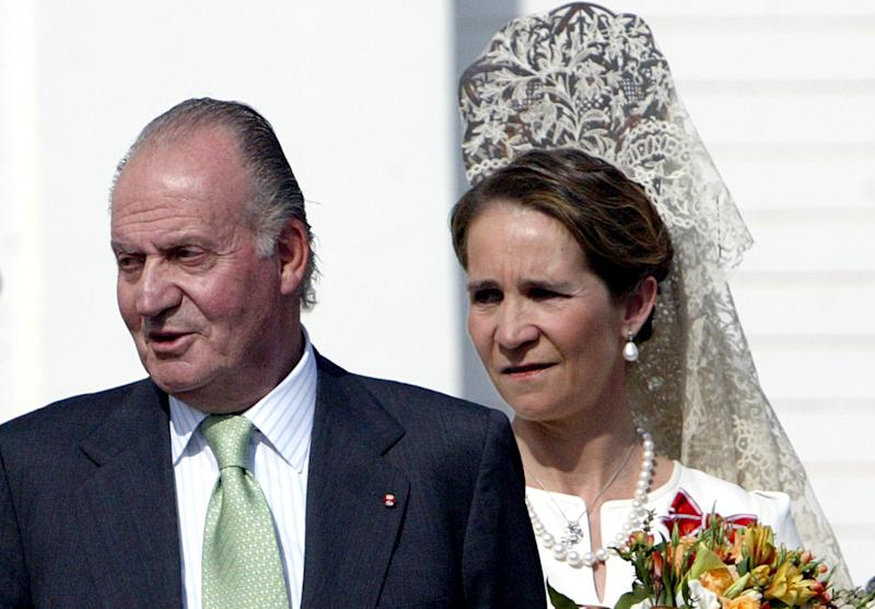 Spanish King Juan Carlos and his daughter Infanta Elena (R) attend the inauguration of the monument in honour of the Spanish King's mother Maria de las Mercedes de Borbon y Orleans, at Maestranza Bullring in Sevilla on May 22, 2008.AFP PHOTO/ CRISTINA QUICLER (Photo credit should read CRISTINA QUICLER/AFP via Getty Images)