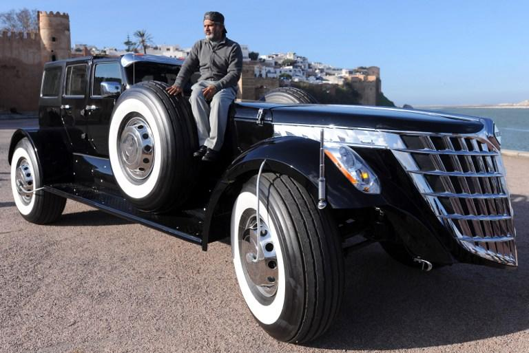 ">TO GO WITH AFP STORY BY FADEL SENNA A member of the Abu Dhabi royal family in the United Arab Emirates (UAE), Sheikh Hamad bin Hamdan al-Nahyan, 55, sits on the roof of his own concept car dubbed the ""Black Spider"", as he poses for a photograph in the Moroccan city of Rabat on January 28, 2013. AFP PHOTO/FADEL SENNA"