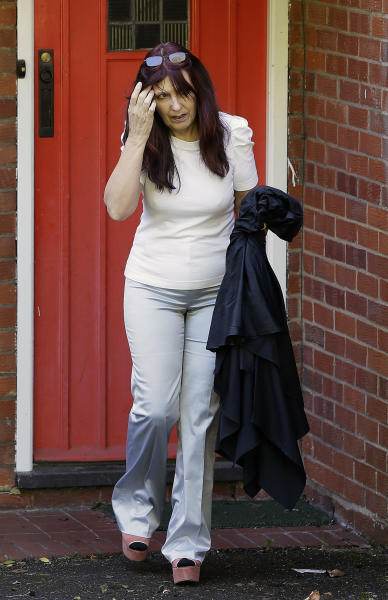 Janis Sharp, the mother of computer hacker Gary McKinnon leaves her home near Hatfield, England, Tuesday, Oct. 16, 2012. Britain's government says Gary McKinnon won't be extradited to the United States, ending his decade-long campaign to avoid trial there over allegations he broke into sensitive military and NASA computer networks. (AP Photo/Kirsty Wigglesworth)