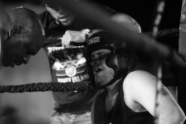 <p>Sgt. Chris Vincenti, right, from the 60th Precinct in Brooklyn, feels the pain in his corner during a grudge match against Ruben Duque at the Brooklyn Smoker in the parking lot of Gargiulo's Italian restaurant in Coney Island, Brooklyn, on Aug. 24, 2017. (Photo: Gordon Donovan/Yahoo News) </p>