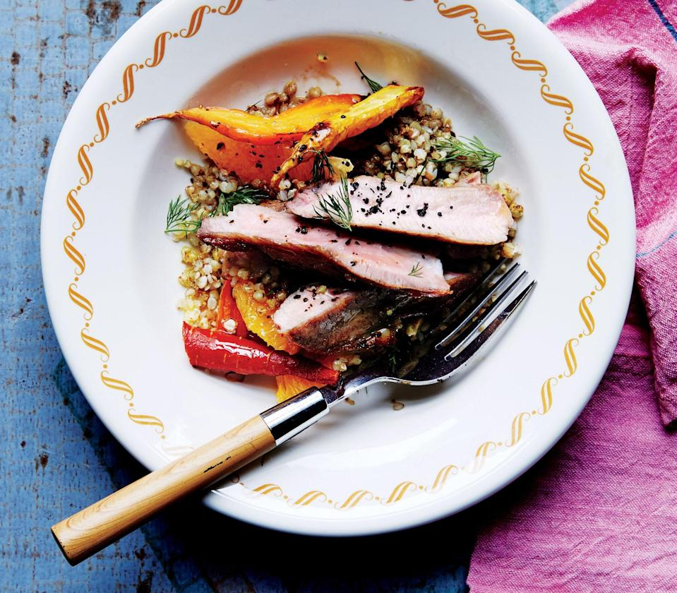 "Chef Sara Kramer cooks the chops medium-rare so they stay juicy; you can also use rib chops. <a href=""https://www.bonappetit.com/recipe/pork-chops-with-carrots-and-toasted-buckwheat?mbid=synd_yahoo_rss"" rel=""nofollow noopener"" target=""_blank"" data-ylk=""slk:See recipe."" class=""link rapid-noclick-resp"">See recipe.</a>"
