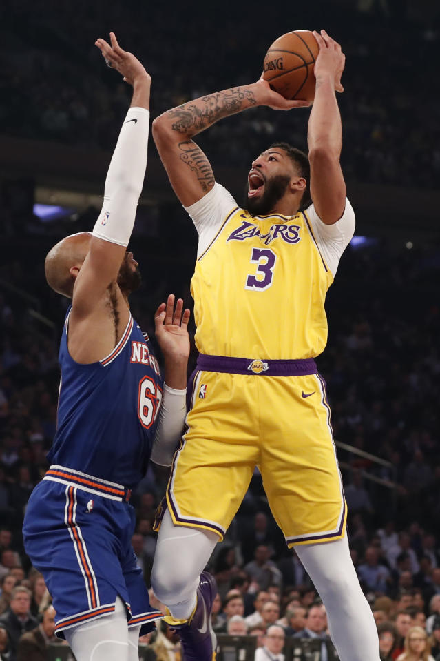Los Angeles Lakers forward Anthony Davis (3) shoots over New York Knicks forward Taj Gibson (67) during the first half of an NBA basketball game in New York, Wednesday, Jan. 22, 2020. (AP Photo/Kathy Willens)