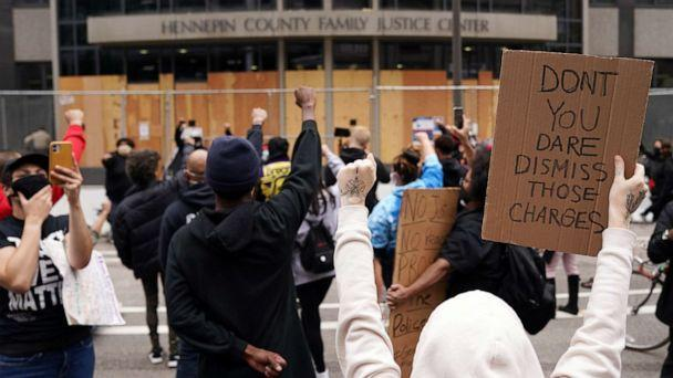 PHOTO: Protesters chant outside the Hennepin County Family Justice Center following a hearing in the cases against four former officers in the killing of George Floyd, in Minneapolis, Sept. 11, 2020. (Star Tribune via Getty Images, FILE)