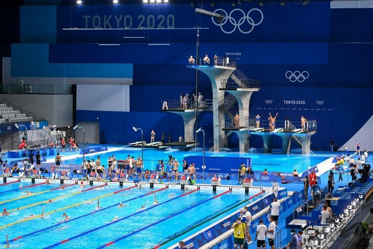 Athletes take part in a swimming training session at the Tokyo Aquatics Centre in Tokyo