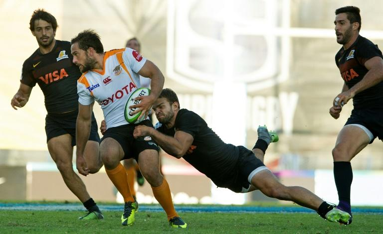 South Africa's Cheetahs fly-half Ruan Van Rensburg (2nd L) is tackled by Argentina's Jaguares wing Ramiro Moyano during their Super Rugby match, at Jose Amalfitani stadium in Buenos Aires, on March 18, 2017