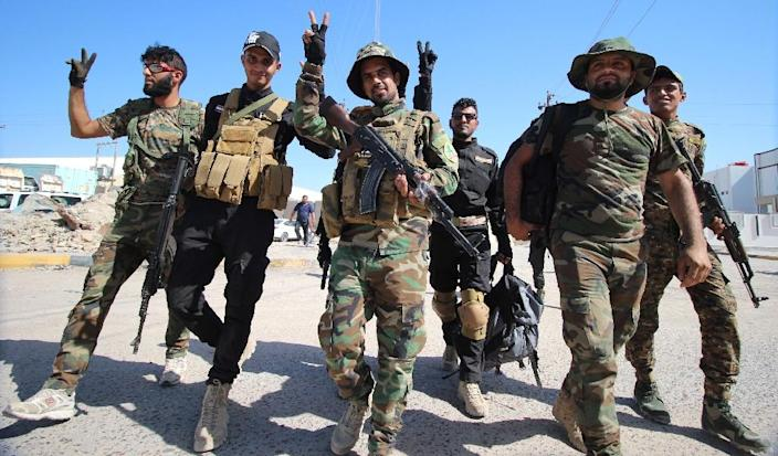 Iraqi fighters of the Shiite group Asaib Ahl al-Haq (The League of the Righteous), a powerful Shiite group that is now one of the leading forces in the Hashed al-Shaabi (AFP Photo/Haidar Mohammed Ali)