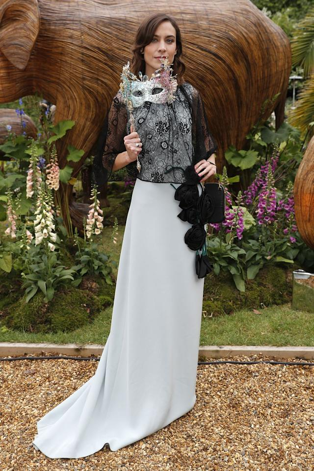 <p><strong>13 June </strong>Alexa Chung chose a Prada gown with black lace detailing for the Animal Ball in London. </p>