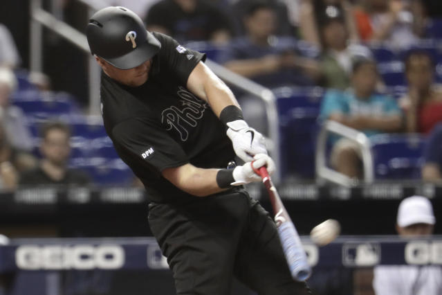 Philadelphia Phillies' Rhys Hoskins hits a two-run home run during the sixth inning of a baseball game against the Miami Marlins, Sunday, Aug. 25, 2019, in Miami. (AP Photo/Lynne Sladky)