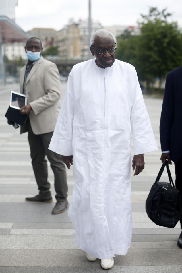 Former president of the IAAF (International Association of Athletics Federations) Lamine Diack arrives at the Paris courthouse, Wednesday, June 10, 2020. A sweeping sports corruption trial opened Monday in Paris involving allegations of a massive doping cover-up that reached to the top of world track and field's governing body. Lamine Diack, 87, who served as president of the body for nearly 16 years, is among those accused of receiving money from Russian athletes to hide their suspected doping so they could compete at the Olympics in 2012 and other competitions. (AP Photo/Thibault Camus)