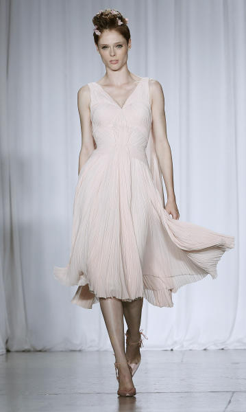 The Zac Posen Spring 2014 collection is modeled during Fashion Week in New York, Sunday, Sept. 8, 2013. (AP Photo/John Minchillo)