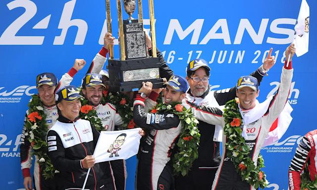 The Toyota team including Fernando Alonso (third left) celebrate after winning the 86th edition of the Le Mans 24 Hours race.