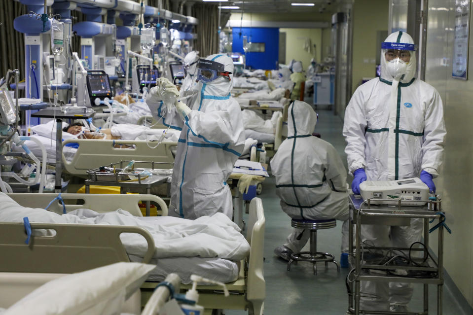 Medical workers treat patients in the isolated intensive care unit at a hospital in Wuhan in central China's Hubei province.