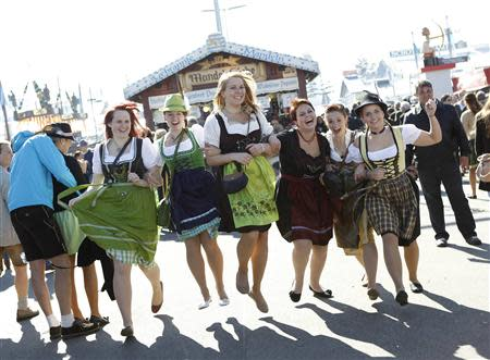 Young women from Baden-Wuerttemberg pose while wearing Bavarian dirndls at Munich's 180th Oktoberfest