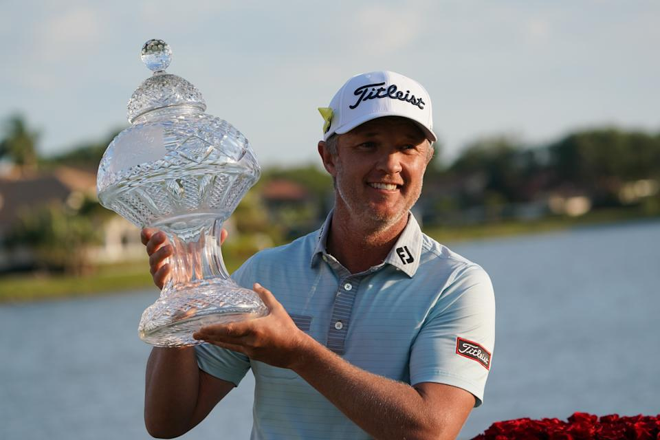 Matt Jones (pictured) raises the trophy after he wins the Honda Classic on March 21, 2021.