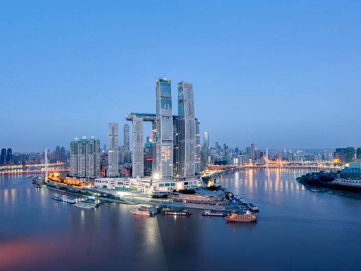 View of the Raffles City Chongqing development from the nearby river.