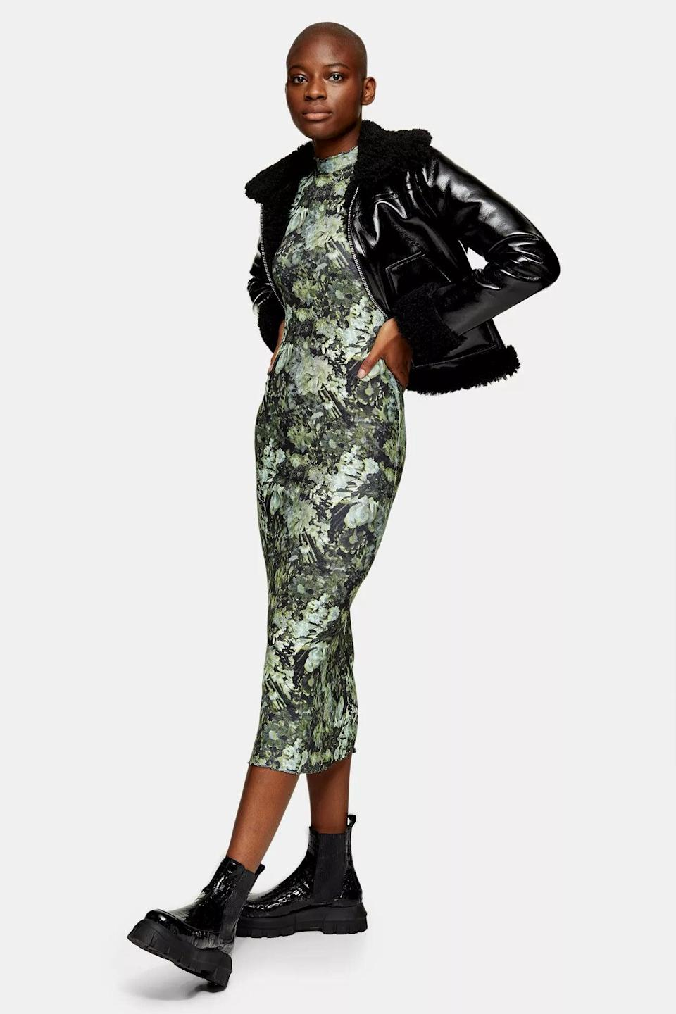 """<h2>Topshop Green Jersey Midi Dress<br></h2><br>This one-and-done bodycon dress gets is our winning pick from reader-favorite retailer Topshop — it's a throw-on-and-go piece that will look festive with heels and cool with flats. We're suckers for the decidedly dramatic, Belgian-influenced floral print, with the dark, moody color scheme of an Old Master painting. <br><br><strong>Topshop</strong> Green Jersey Midi Dress, $, available at <a href=""""https://go.skimresources.com/?id=30283X879131&url=https%3A%2F%2Fus.topshop.com%2Fen%2Ftsus%2Fproduct%2Fnew-in-this-week-2169940%2Fnew-in-dresses-4938916%2Fglitch-jersey-midi-10083041"""" rel=""""nofollow noopener"""" target=""""_blank"""" data-ylk=""""slk:Topshop"""" class=""""link rapid-noclick-resp"""">Topshop</a>"""