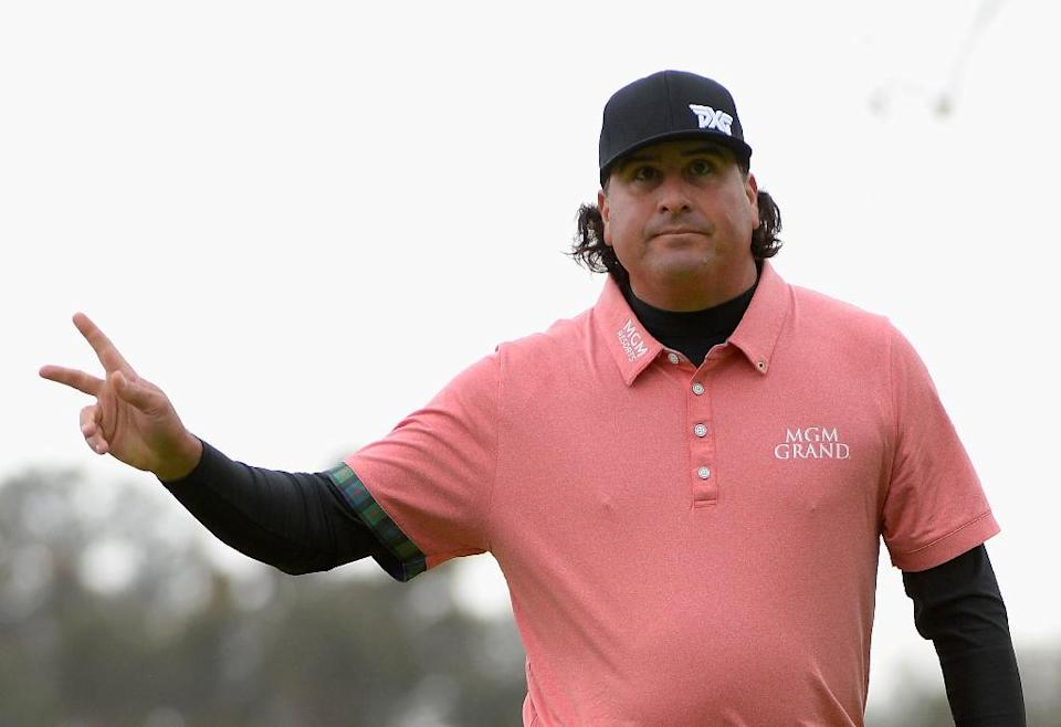 Pat Perez reacts to his birdie on the 18th hole during a continuation of the second round at the Genesis Open in Pacific Palisades, California (AFP Photo/ROBERT LABERGE)