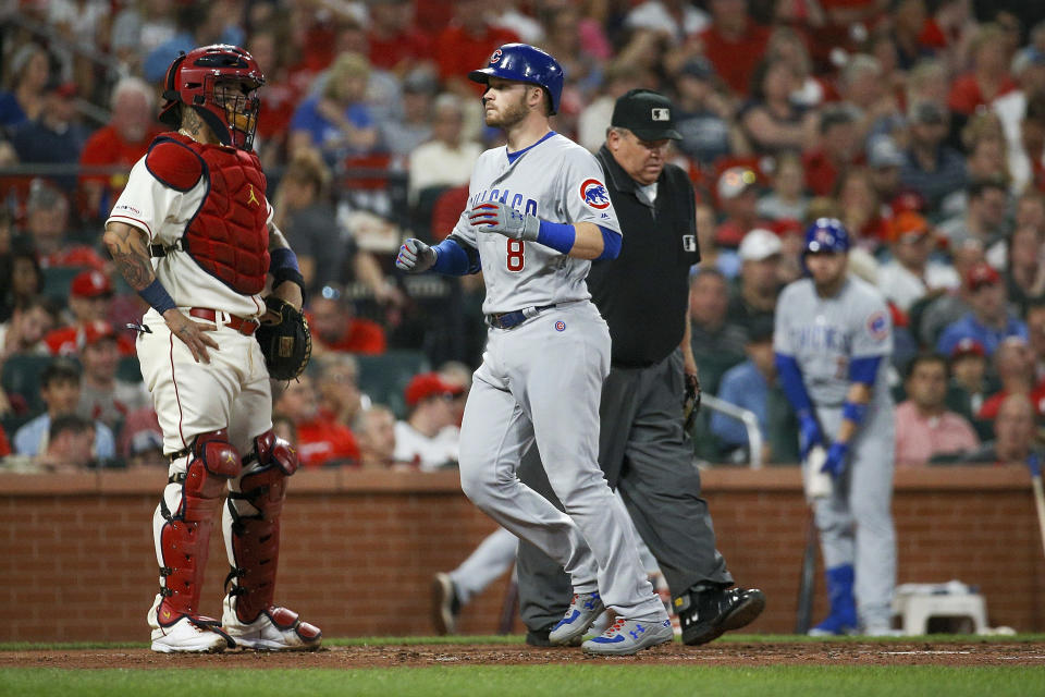 Chicago Cubs' Ian Happ, front right, scores on a two-run home run as St. Louis Cardinals catcher Yadier Molina, left, stands nearby during the third inning of a baseball game Saturday, Sept. 28, 2019, in St. Louis. (AP Photo/Scott Kane)