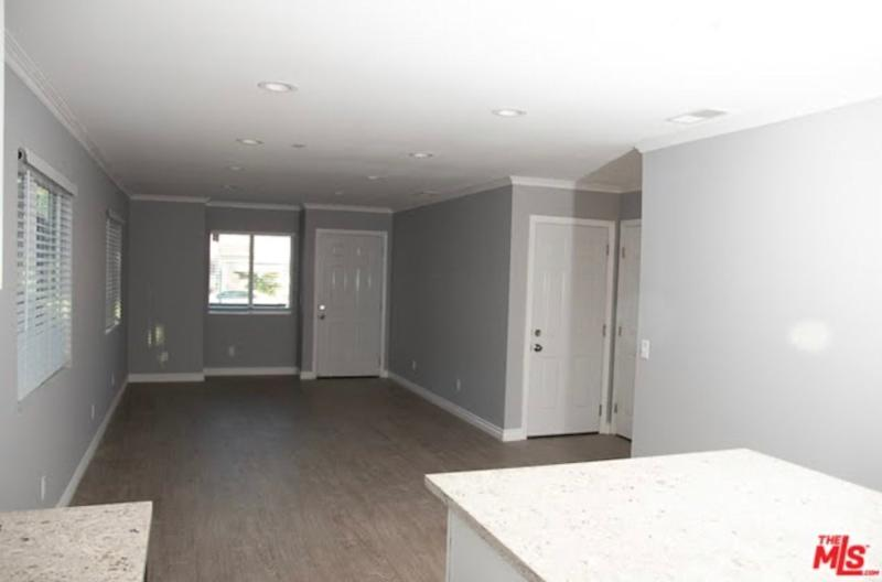 BEFORE: Before the renovations, the home was a new construction, built in 2019. The layout felt closed-off and lacked personality.