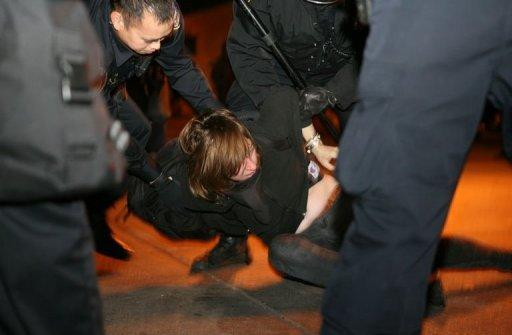 <p>A protester from Occupy Oakland -the local offshoot of Occupy Wall Street- is arrested in Oakland on January 28. Riot police fired tear gas and arrested more than 400 people in Oakland, California, as hordes of anti-Wall Street protesters tried to take over downtown buildings including City Hall, police said.</p>