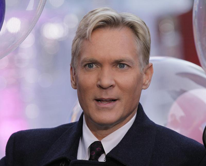 """This Oct. 17, 2012 photo shows Sam Champion, the weather anchor of ABC's """"Good Morning America"""" program in New York's Times Square. Weather Channel President David Clark announced Monday, Dec. 2, 2013, that Champion will anchor the network's new flagship morning show, which is set to debut in early 2014. Champion, who will be based at the Weather Channel headquarters in Atlanta, will also assume managing editor responsibilities at the network. His last day on """"GMA"""" is Wednesday. He had been on that program since 2006. He joined local New York station WABC in 1988. (AP Photo/Richard Drew)"""