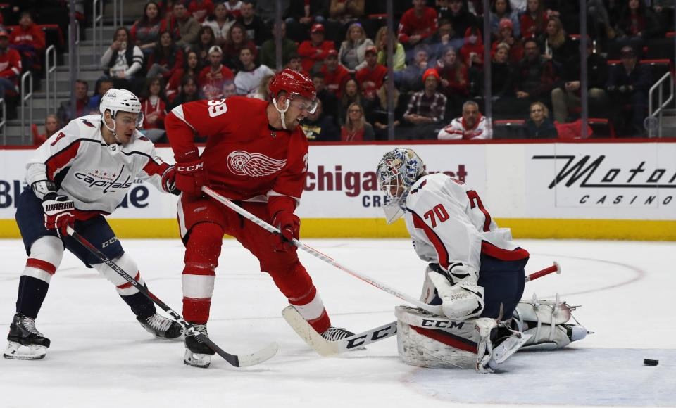 FILE - Detroit Red Wings right wing Anthony Mantha (39), center, shoots the puck past Washington Capitals goaltender Braden Holtby (70) for a goal during the first period of an NHL hockey game in Detroit, in this Sunday, Jan. 6, 2019, file photo. All divisional play during this shortened NHL season gives an added perk to most of the players traded at the deadline: They'll get to face different teams. Anthony Manta gets to bang bodies with the Islanders, Penguins and Bruins he hasn't seen in more than a year after joining the Capitals. (AP Photo/Carlos Osorio, File)