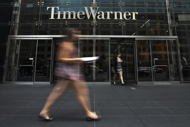 A woman walks past the Time Warner Center near Columbus Circle in Manhattan, New York
