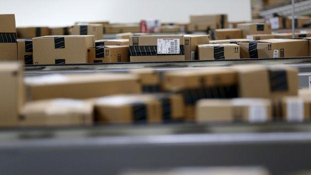 Packaged products that are ready for shipment are seen at an Amazon Fulfilment Center