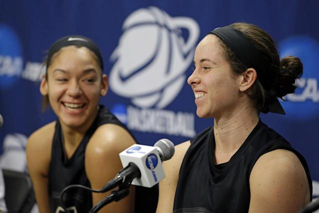 Purdue guard Courtney Moses, right, and forward Whitney Bays laugh as they are questioned during an NCAA women's college basketball tournament news conference in West Lafayette, Ind., Sunday, March 23, 2014. Purdue faces Oklahoma State in a second round game on Monday. (AP Photo/Michael Conroy)