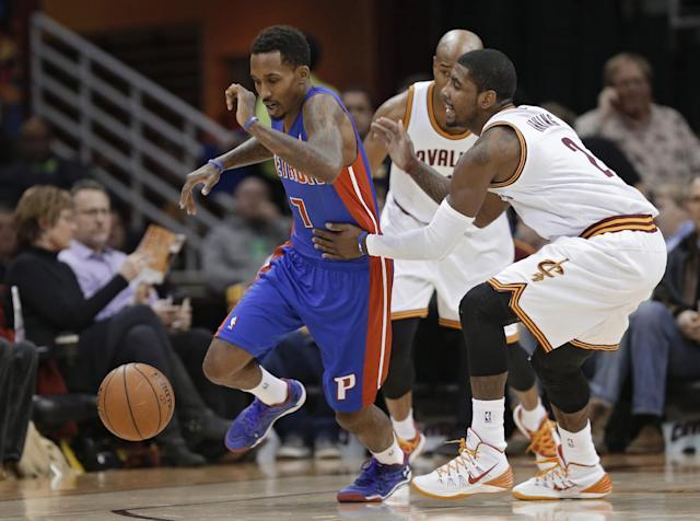 Cleveland Cavaliers' Kyrie Irving, right, fouls Detroit Pistons' Brandon Jennings (7) during the first quarter of an NBA basketball game Monday, Dec. 23, 2013, in Cleveland. (AP Photo/Mark Duncan)