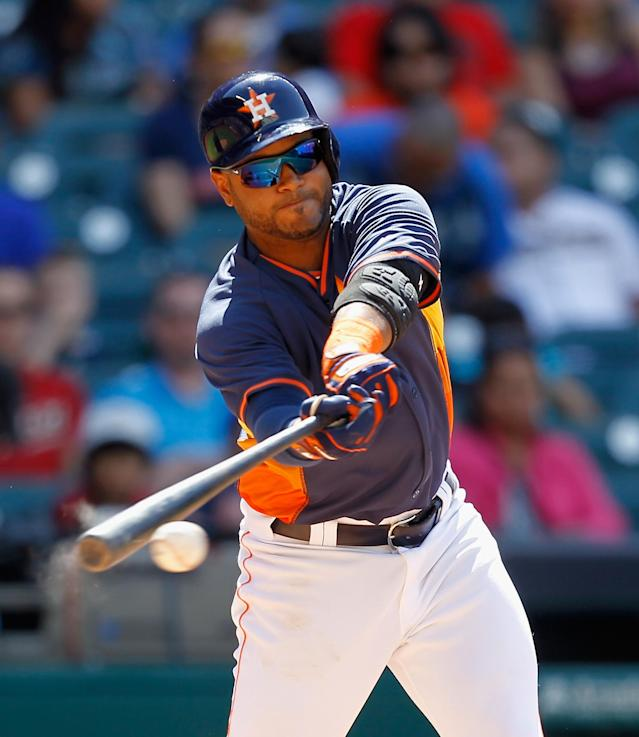 Houston Astros' Gregorio Petit hits a line drive to right field in the seventh inning of a spring exhibition baseball game against Rojos del Aguila de Veracruz on Sunday, March 30, 2014, in Houston. Houston won 6-1. (AP Photo/Bob Levey)