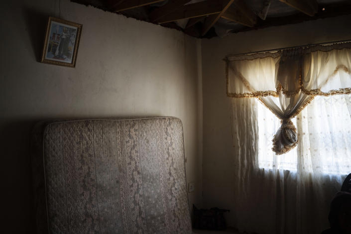 The mattress on which 12-year-old Onthatile Mohapi once slept leans against the wall of his bedroom in Damonsville, South Africa, on June 8, 2020. Mohapi's body was found in a dam 7 kilometers from his home. The pathology report said the boy drowned, but his mother believes he was murdered. (AP Photo/Bram Janssen)
