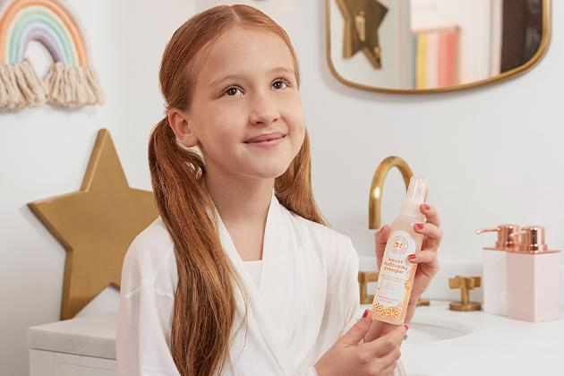 Jessica Alba's daughter Haven holding one of her favourite Honest Beauty products during her morning routine.