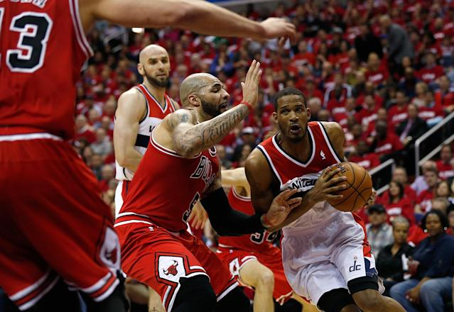 WASHINGTON, DC - APRIL 25: Trevor Ariza #1 of the Washington Wizards drives to the basket against Carlos Boozer #5 of the Chicago Bulls in first quarter action of Game 3 of the Eastern Conference Quarterfinals against the Chicago Bulls during the 2014 NBA Playoffs at the Verizon Center on April 25, 2014 in Washington, DC. NOTE TO USER: User expressly acknowledges and agrees that, by downloading and or using this photograph, User is consenting to the terms and conditions of the Getty Images License Agreement. (Photo by Win McNamee/Getty Images)