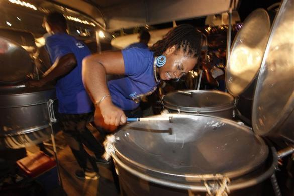 Members of WITCO Desperadoes steel orchestra play at the semi-finals of the National Panorama Steelband competition in Queen's Park Savannah, Port of Spain, late February 5, 2012.