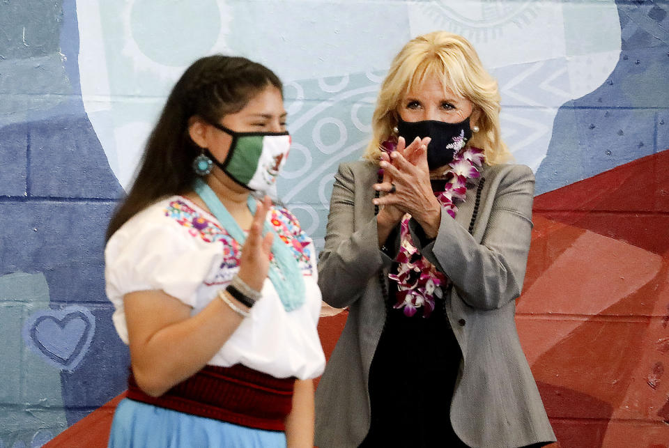 Glendale Middle School eighth grader Rosa Sanchez receives applause from first lady Jill Biden as she walks to the podium to speak at Glendale Middle School in Salt Lake City, Wednesday, May 5, 2021. Biden visited the school to thank teachers for their diligence and hard work during the pandemic. (Laura Seitz/The Deseret News via AP)