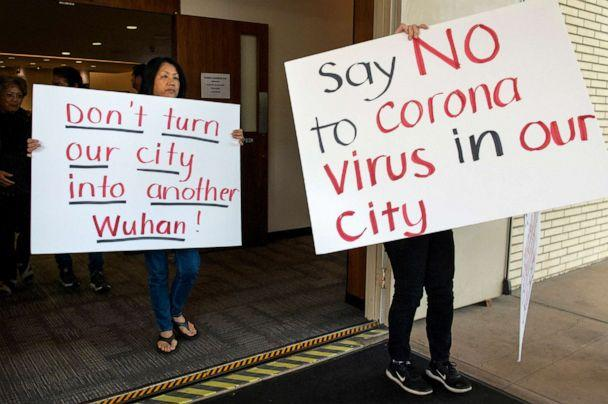 PHOTO: Mary Cahill, left, leaves a news conference where officials discussed the proposal for housing coronavirus patients at the Fairview Development Center in Costa Mesa, Calif on Feb. 22, 2020. (Mindy Schauer/AP)