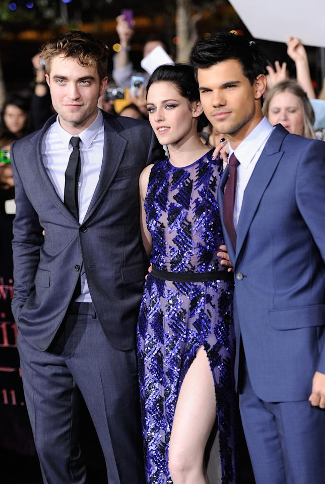 "LOS ANGELES, CA - NOVEMBER 14:  (L-R) Actors Robert Pattinson, Kristen Stewart and Taylor Lautner arrive at Summit Entertainment's ""The Twilight Saga: Breaking Dawn - Part 1"" premiere at Nokia Theatre L.A. Live on November 14, 2011 in Los Angeles, California.  (Photo by Frazer Harrison/Getty Images)"