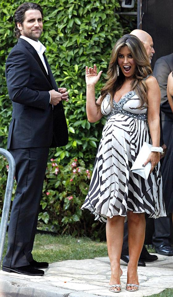 """Fox Sports personality Jillian Barberie Reynolds brought along two guests -- her baby bump, and hubby Grant Reynolds, who's featured on the reality show """"Househusbands of Hollywood."""" Jean Baptiste Lacroix/<a href=""""http://www.wireimage.com"""" target=""""new"""">WireImage.com</a> - September 27, 2009"""